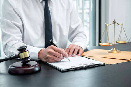 Male lawyer working with legal case document contract in office, law and justice, attorney, lawsuit concept.