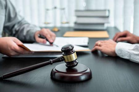 Male lawyer discussing negotiation legal case with client meeting with document contract in office, law and justice, attorney, lawsuit concept. Banque d'images