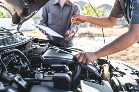 Technician team working of car mechanic in doing auto repair service and maintenance worker repairing vehicle with checking oil, Service and Maintenance car check.