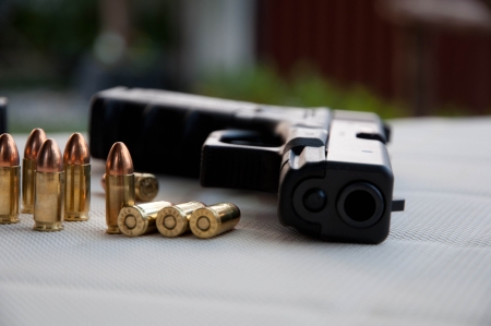 Gun and bullet photo