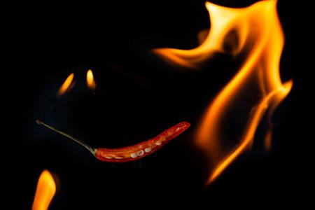 Burning chili on black background Stock Photo