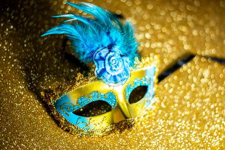 Fancy mask on gold background Imagens