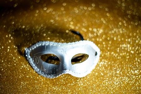 Fancy mask on gold background Stock Photo