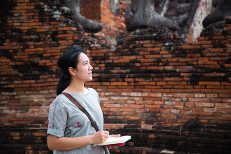 Beautiful women travel on Ayutthaya Historical Park Thailand