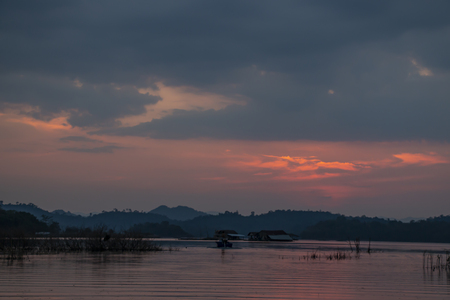 Sunset at the lake and rain strom Stock Photo