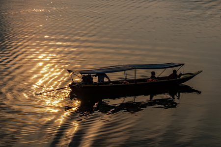 Silhouette of boat in the river at sunset
