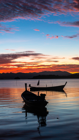 Fishing boat in the sea at sunrise