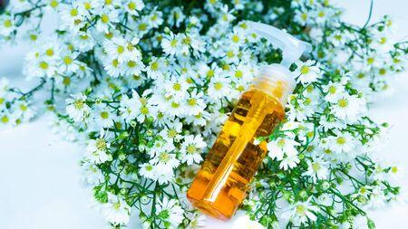 Perfume bottle on flower Stock Photo