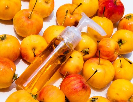 Perfume bottle on apple Stock Photo