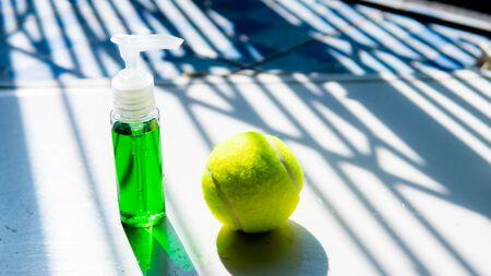 Perfume bottle and tennis ball is sport cosmetic 版權商用圖片