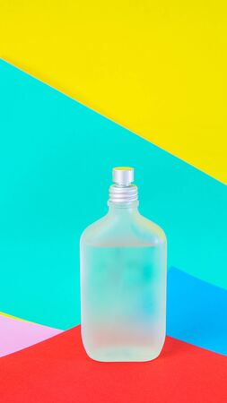 Perfume bottle on color paper