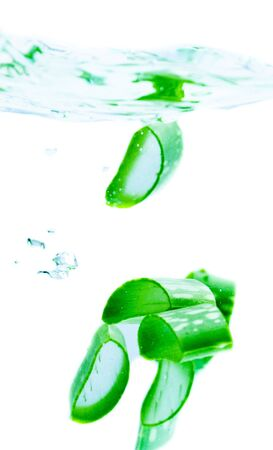 Fresh aloe vera splashing in water Archivio Fotografico - 133555131
