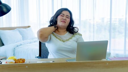 Fat women unwell from office syndrome 写真素材