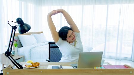 Fat women exercise in the home office