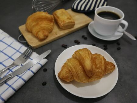 Croissant and Chicken Pie with black coffee