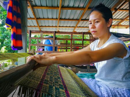 HDR image for made mat by loom. Woman live in the countryside making basketwork. Pallet is the wicker from jute.