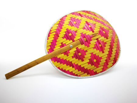 A fan made from bamboo stick in graphic pattern, isolated on white