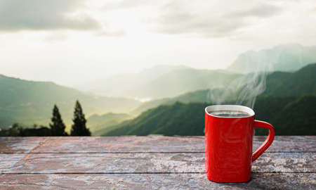 freshly brewed coffee or espresso into a red cup and coffee mug. Hot coffee in a mug placed on the tabletop or wooden balcony. Morning mountain view, morning sunshine. 3D Rendering Standard-Bild