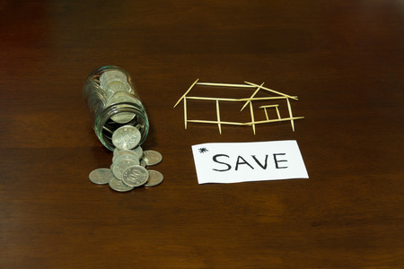 toothpick: Coins and picture house from Toothpick Stock Photo