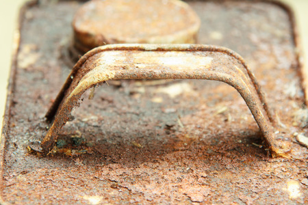 rusts: Handle of old rectangular can with rusts