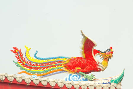 chinese red swan on roof top photo