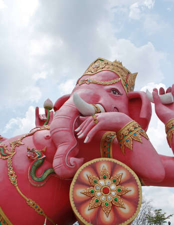 pink ganesh in front of blue sky photo