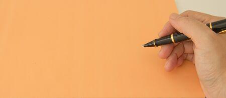 hand pen orange paper photo
