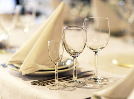 Glasses and plates on table in restaurant photo