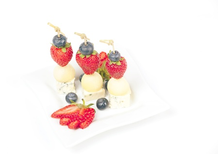 Canapes on a plate with cheese melon and strawberries Stock Photo - 21408188