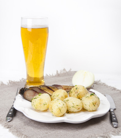 kipper: Smoked mackerel fish on a plate with boiled potatoes