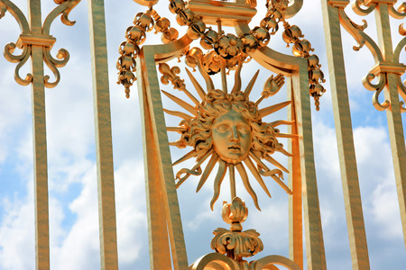 Details on gate of Versailles palace fence near Paris, France - Golden fence of Versailles day shoot in front of palace