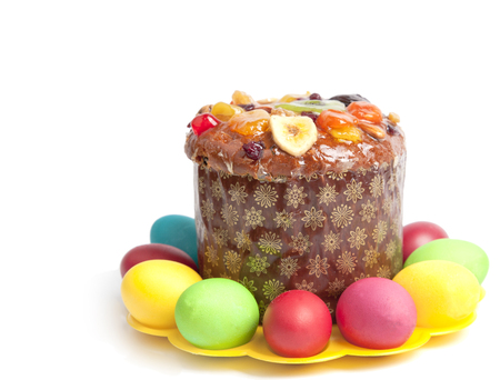 Traditional Christian Easter cake with painted eggs on the plate, isolated on a white background Stock Photo