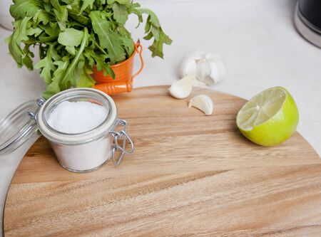 Cutting board with salt and herbs closeup Stock Photo
