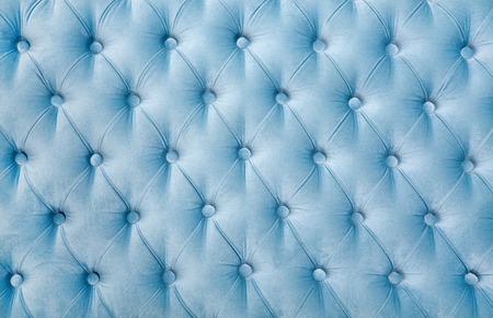 Texture of the old blue leather upholstery with buttons, retro furniture