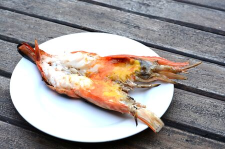 cleave: Grilled Giant River Prawn - shrimp it - cleave on white dish and wood background