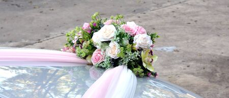 bonnet: Rose artificial flowers bouquet on the bonnet car - wedding ceremony Stock Photo