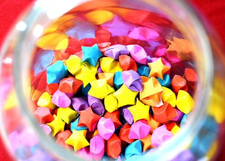 glass paper: folded paper star pattern colorful in a glass jar - selective focus on star
