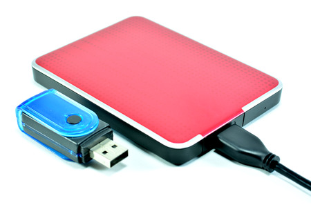 card reader: Red external harddisk and Cable USB and adapter card reader oblique on the white background Stock Photo