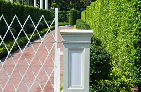 pearly gates: Gate post - No passing through with the tree background Stock Photo