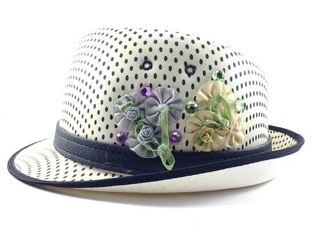 prety: Side of prety hat with flowers bow on white background. Stock Photo