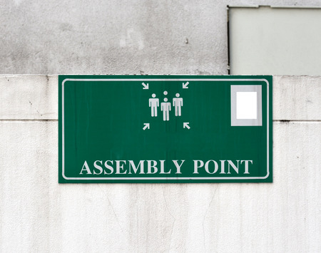 assembly point: Green sign assembly point