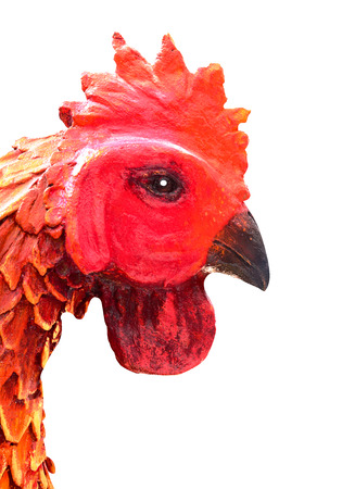 face side: The red face side of gamecock chicken statue on white background