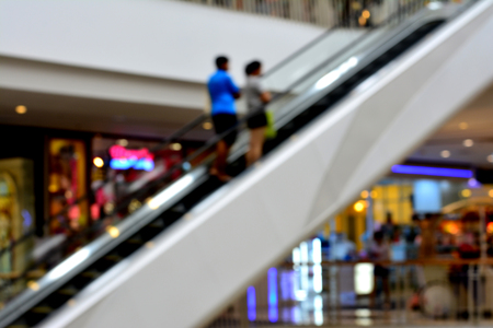 peoples: Blurred - Escalator with two peoples