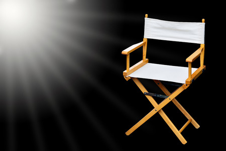 filmmaker: Film director chair or movie film industry of concept on light black color background