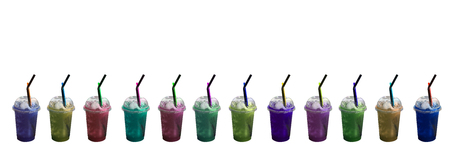 slushy: Twelve of colorful slushy ice drinks in plastic cups on isolated white background and copy space with horizantal style