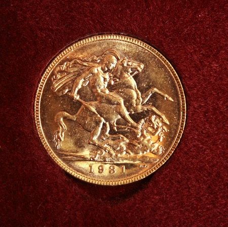 Australia 1931 full gold sovereign on red background photo