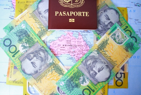 australian dollars: Passport and Australian dollars in Australia map background Stock Photo