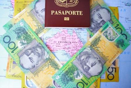 immigrants: Passport and Australian dollars in Australia map background Stock Photo