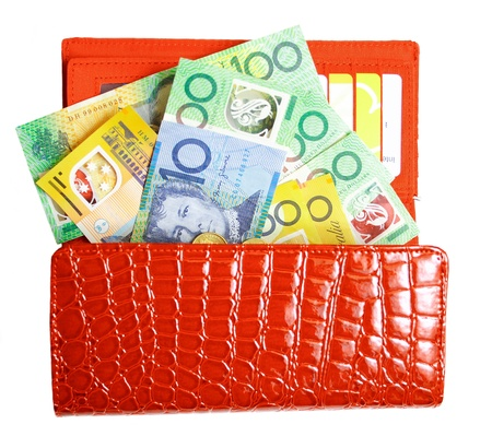 red purse: A beautiful, red-leather wallet filled with Aussie dollars isolated on white
