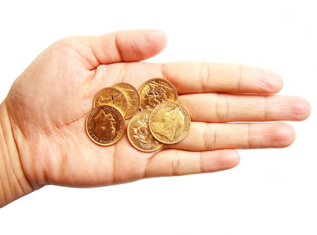 Woman hand holding Australia full and half gold sovereign on isolated white background photo